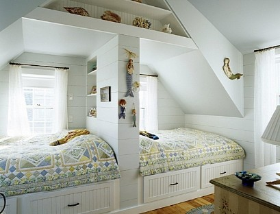 Two children's beds by the window