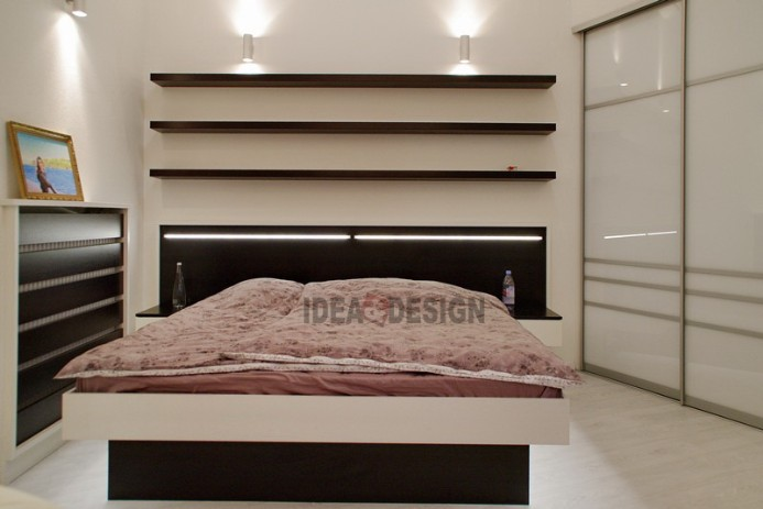 Photo of a double bed with lighting in the headboard