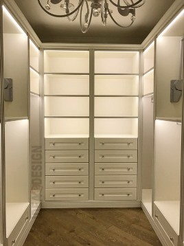Classic walk-in closet with lighting