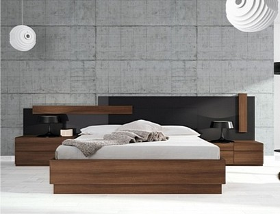 A beautiful bed with a glossy headboard