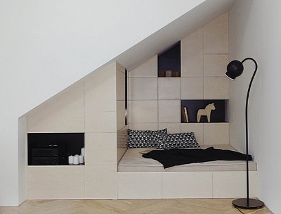 Attic closet with a bed