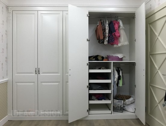 Closet in the children's room in classic style