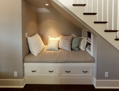 Built-in sofa under the stairs